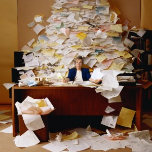 Executive Buiried under piles of paperwork